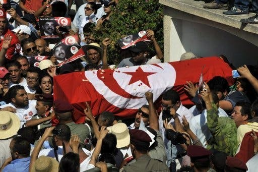 Tunisian mourners carry the coffin of assassinated opposition leader Mohamed Brahmi on Saturday. (AFP)