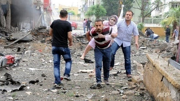 An injured woman is carried to safety after the car bomb in Reyhanli earlier this month. AFP