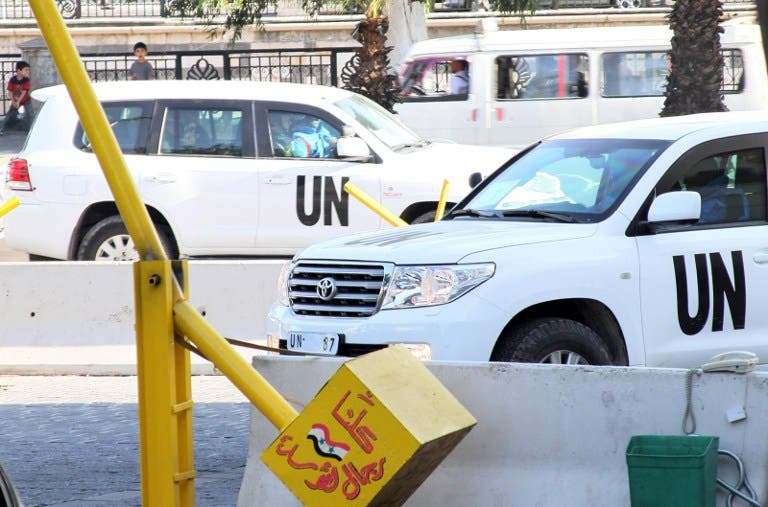 UN inspectors are seen arriving at the hotel in Damascus on August 26, 2013, following their return from an inspection of a suspected chemical weapons attack in Moadamiyet al-Sham. (AFP)