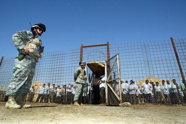 US soldiers guard the notorious Abu Ghraib prison as detainees are released (Getty Images)