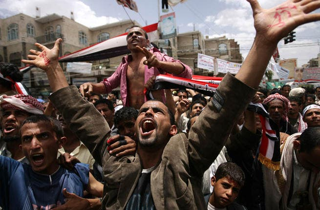 Demonstrators pictured in Yemen's capital, Sana'a, during protests to oust Ali Abdullah Saleh in 2011.