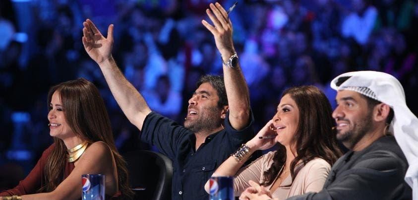 Wael and Elissa share a joke on-screen.