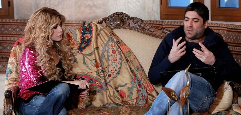 Nawal al Zoghbi and Wael cosy up on the couch.