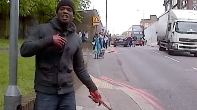 A screen grab of one of the suspects wielding a knife after beheading a man in London on Wednesday.