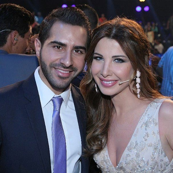 Celebrity judge Nancy Ajram hugs Ziad Khoury goodbye (Photo posted to Instagram and Ziad Khoury's Facebook page)