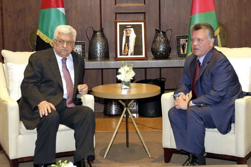 "Jordan's King Abdullah II (R) and Palestinian President Mahmoud Abbas (R) signed an agreement confirming their ""common goal to defending"" Jerusalem. (AFP)"