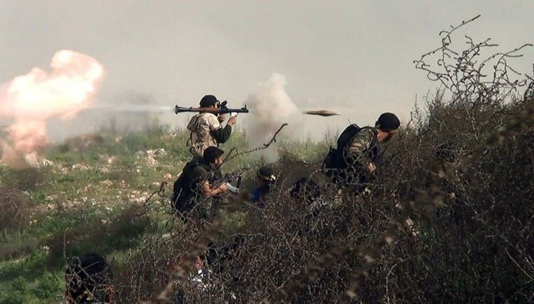 An image grab taken from a video shows an opposition fighter firing an rocket propelled grenade (RPG) on August 26, 2013 during clashes with regime forces over the strategic supply routes in and out of Aleppo. (AFP)