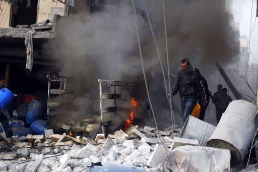 Regime airstrikes targeting a rebel compound left 26 dead Saturday after the attack missed its target and hit the nearby Nafasin market (Mohammed Al Khatieb/AFP)