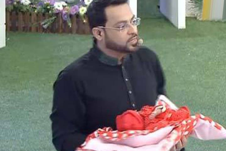A snapshot from Hussain's show, Aman Ramzan, where he gives away free babies. (Image: Facebook)