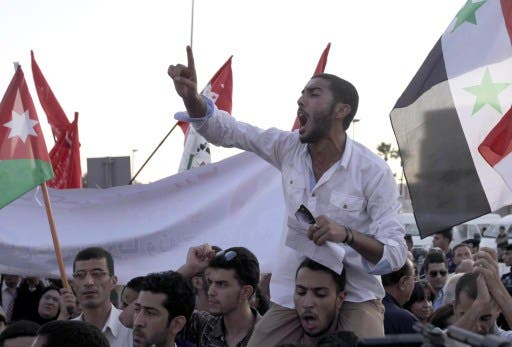 ordanian opposition protesters shout slogans during a anti-US demonstration outside the US embassy on September 1, 2013 in the Jordanian capital Amman. (AFP)