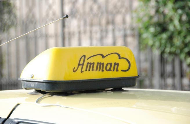 A yellow Taxi cab in Amman.