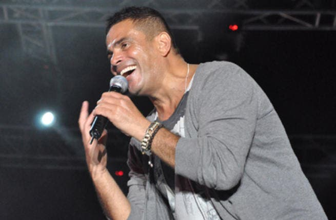Amr Diab was filmed secretly holding a concert in Greece. (Image: Facebook)