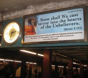 The ads show a burning World Trade Center with a quote attributed to the Quran.