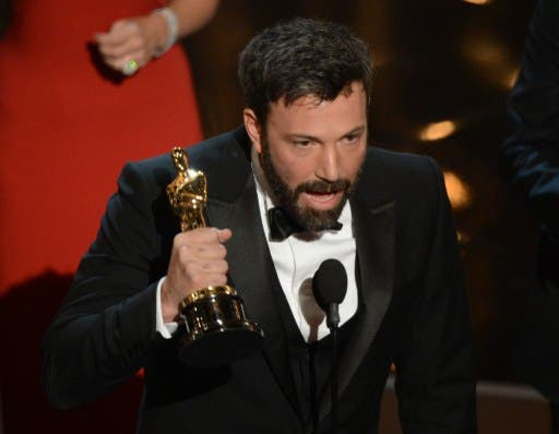 Argo director Ben Affleck accepts the Oscar for Best Movie at the 85th Annual Academy Awards (Photo: AFP / Robyn Beck)