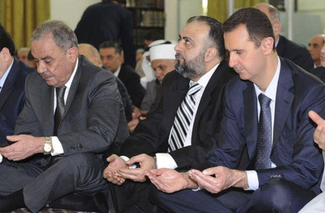 Assad comes out to pray in an exclusive Eid Mosque appearance