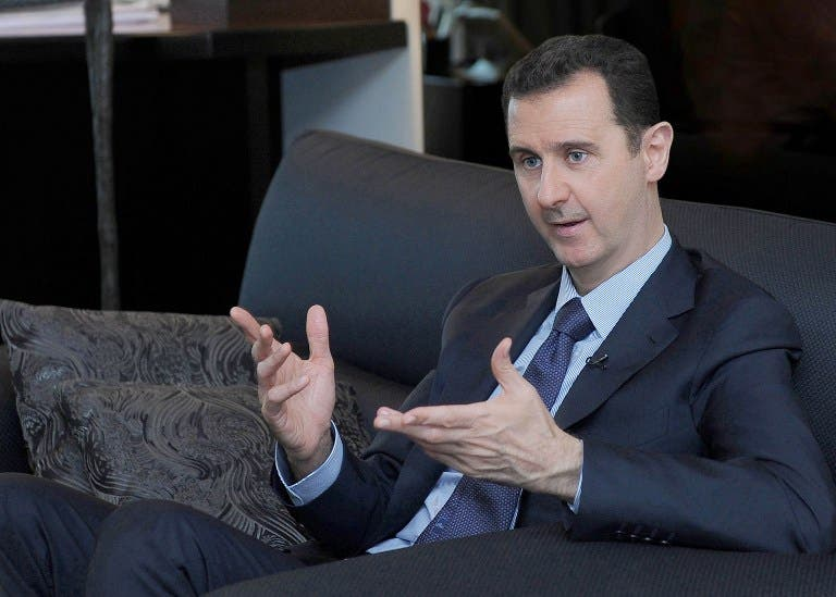 SYRIA, DAMASCUS : A handout picture released by the Syrian Arab News Agency (SANA) on August 26, 2013 shows Syrian President Bashar al-Assad giving an interview with Russian newspaper Izvestia in Damascus, during which he warned the United States of