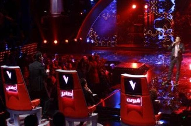 Finalist Murad Buriqi gets Assi on his feet (Photo: The Voice)