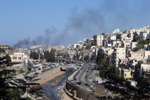 Smoke rises from above Tripoli's predominantly Sunni Bab Al-Tabbaneh neighborhood following days of fatal clashes with the Alawite neighborhood of Jabal Mohsen (Joseph Eid/AFP)