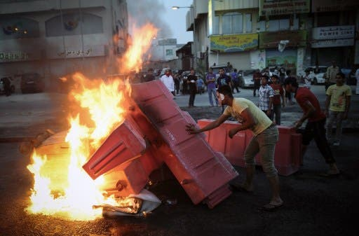 Bahraini protesters put fire on barricades during clashes with riot police following a protest against the Formula One Grand Prix on Friday in the village of Sanabis, west of Manama. (Photo: AFP PHOTO/MOHAMMED AL-SHAIKH)