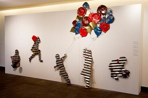 Katanani's wall installation depicts children at play. (The Daily Star/Hasan Shaaban)