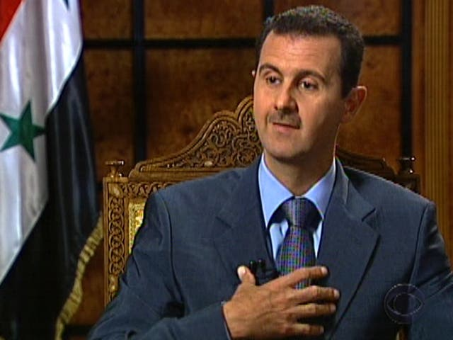 Syrian President Bashar Assad warned the United States that it would fail if it invaded Syria, as he refuted any claims that his government was involved in the use of chemical weapons against civilians. (AFP/File)