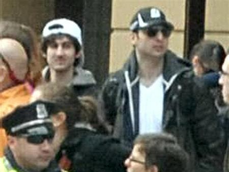 Blurry images show the Tsarnaev brothers at the Boston Marathon shortly before they planted the bombs that killed three people.