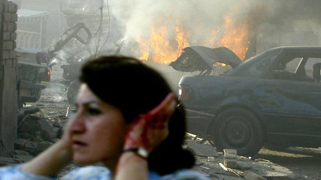A woman holds her ears while fleeing one of the many car bomb atacks that have targeted Middle East countries over the past year (AFP)