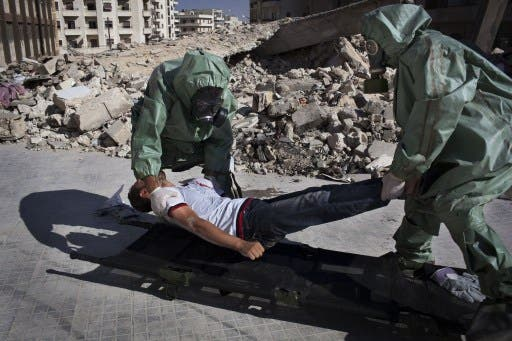 Volunteers take part in a simulation of how to respond to a chemical attack, in the northern Syrian city of Aleppo on September 15, 2013. Saudi Arabia on Tuesday said the use of chemical agents should not be allowed to 'minimise' the Syrian crisis. (AFP)