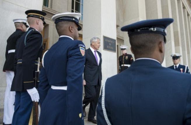 US Secretary of Defense Chuck Hagel waits for UN Secretary-General Ban Ki-moon to arrive for meetings at the Pentagon on Thurday in Arlington, Virginia. (Photo: AFP)