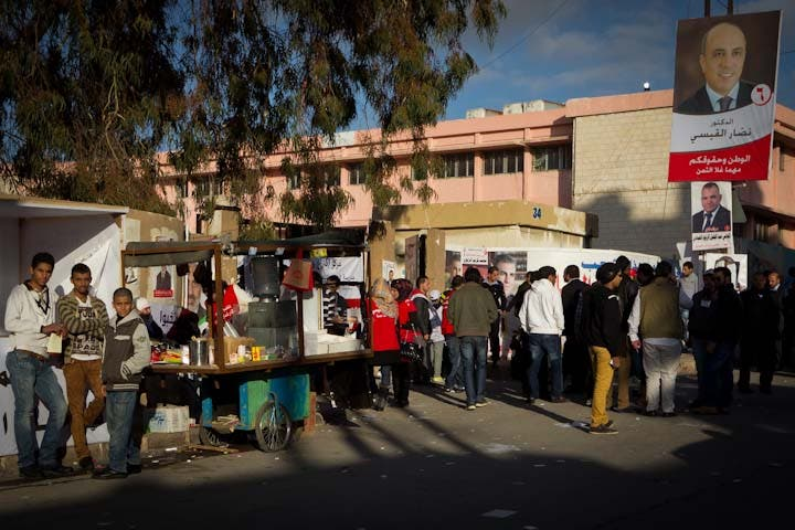 Coffee vendors try to profit from election day, pitching up in a busy polling station in central Amman