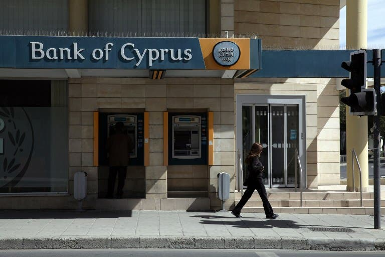 Arab banks have threatened a pull out from Cyprus (YIANNIS KOURTOGLOU / AFP)