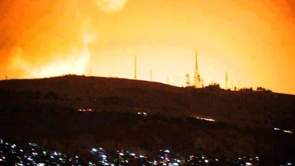 Damascus sky lights up following the heavy blasts that shook the capital early Sunday. (Al Arabiya)