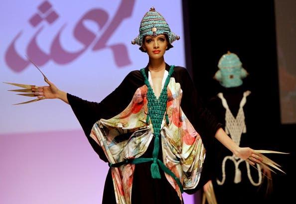 A model presents a creation of Emirati designer Abir al-Suwaidi during Spring/Summer 2011 Dubai Fashion Week in the Gulf emirate.