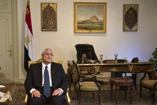 Interim President Adly Mansour made the announcement about the switch in the order of presidential and parliamentary elections a day after Egypt's revolution anniversary clashes left dozens killed (File Archive/AFP)