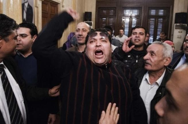 An unidentified Egyptian man shouts slogans against Egypt's President Mohamed Morsi and in support of an election boycott during a meeting of leaders from the Egyptian National Salvation Front (NSF) in Cairo in February. (Photo:  AFP / Gianluigi Guercia)
