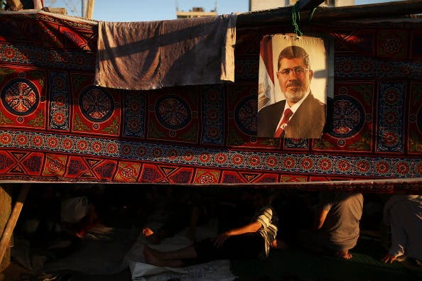 A picture of Mohamed Morsi hangs from a supporter's tent on July 10, 2013. (source: Getty / Spencer Platt)