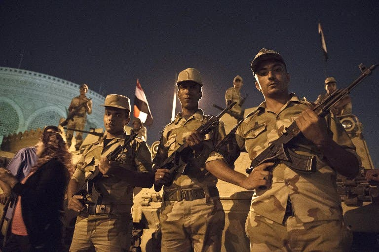 Soldiers stand guard outside Egypt's presidential palace on July 19. (AFP / KHALED DESOUKI)