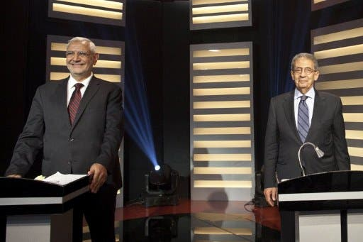 Presidential candidate and former Arab League Secretary General Amr Mussa (R) and moderate Islamist candidate, Abdelmoneim Abul Fotouh, during a live debate in Cairo.