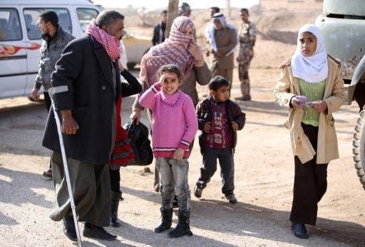 Iraqi civilians flee Fallujah ahead of the government forces' planned attack (Ahmad Al Rubaye/AFP)