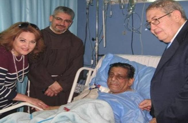 Farouk and his family by his bedside in hospital before he passed away. (Image: Facebook)