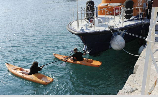 Canadian activists using Kayaks to prevent arrest or raid of their flotilla by the Greek coastal authorities (to no avail but a courageous effort). Photo courtesy of 'Desert Peace'.
