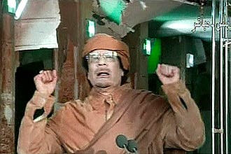 A defiant Col Muammar Gaddafi evaded capture for the first weekend as a reward of two million Libyan dinars offered for the fugitive Libyan leader, dead or alive.