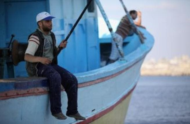 Gaza fishermen test their new freedom after the ceasefire allows them to set sail up to six miles from shore. (Christopher Furlong/Getty Images)