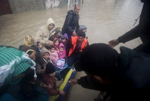 Rescue services have been evacuating thousands of Gazans from their homes due to heavy flooding that has left many homes underwater (Mahmud Hams/AFP)