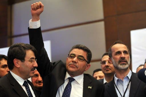 Prime Minister Ghassan Hitto with other members of the Syrian opposition (AFP)
