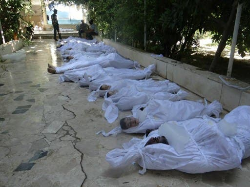 The bodies of young children killed by a chemical weapons attack in the Damascus suburbs on August 21 are lined up in a makeshift morgue. A new report suggests the the UK government sold Assad's regime the chemical ingredients used in the attack. (AFP/File)