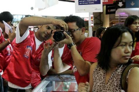 Man uses camera (Gulf News Photo)