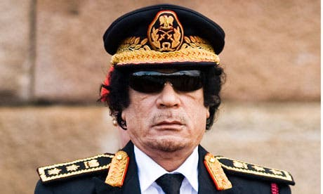 Turning in his grave: former Libyan leader Muammar Gaddafi was allegedly an active sexual abuser of young girls, kidnapping and imprisoning them at a young age for his own sexual desires, according to a new tell-all book published on the dictator. (AFP/File)
