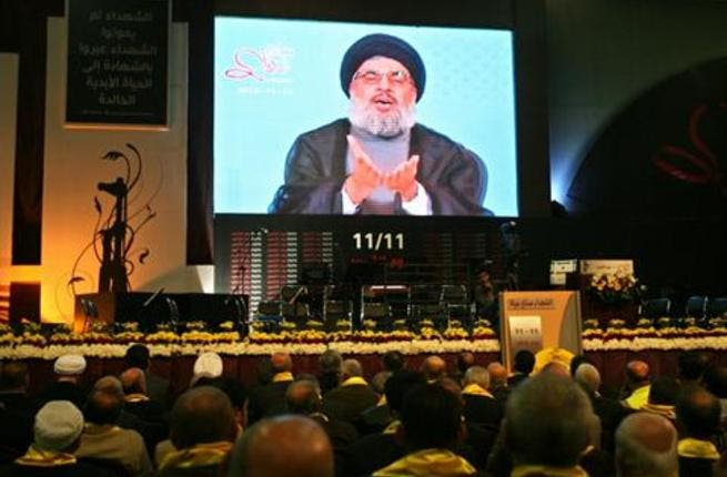 Hezbollah leader Sayyed Hasan Nasrallah speaks on a TV screen during a ceremony in Beirut  (The Daily Star/Hasan Shaaban)