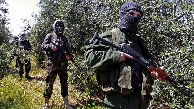 Hezbollah fighters in Syria supported Syrian regime attacks in Damascus (Associated Press)